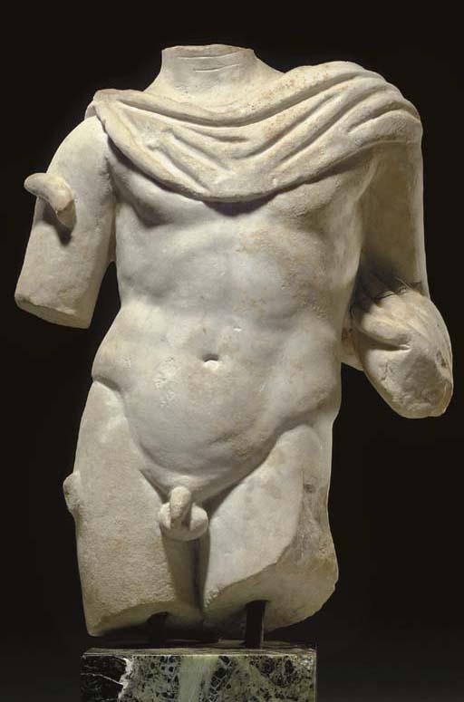 A ROMAN MARBLE TORSO OF A GOD