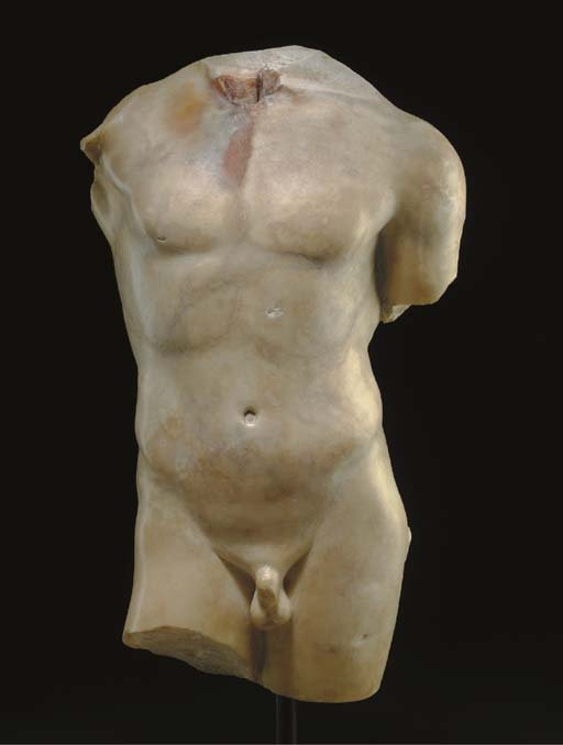 A ROMAN MARBLE TORSO OF A YOUNG MAN