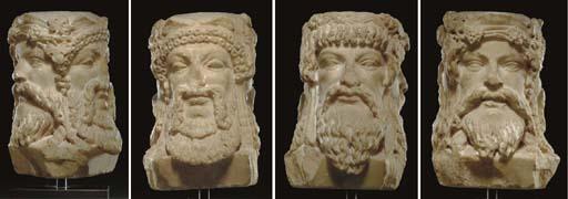 A ROMAN MARBLE TRIPLE-HEADED HERM OF BACCHUS