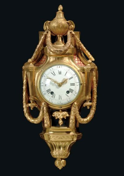 A FRENCH ORMOLU CARTEL CLOCK