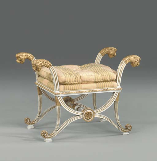 AN AUSTRO-HUNGARIAN WHITE-PAINTED AND PARCEL-GILT STOOL