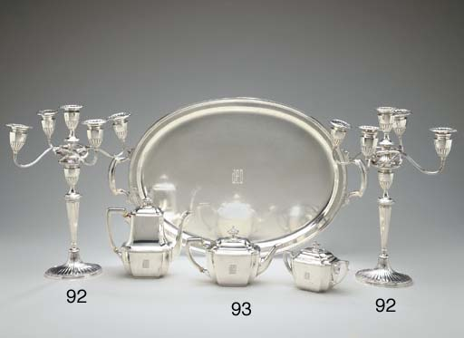 AN AMERICAN SILVER THREE-PIECE TEA AND COFFEE SERVICE WITH TRAY**