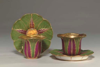 A PAIR OF SEVRES CUPS AND SAUC