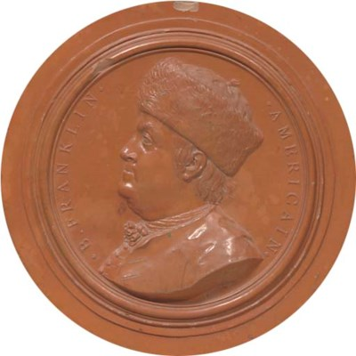 A TERRACOTTA RELIEF PLAQUE OF