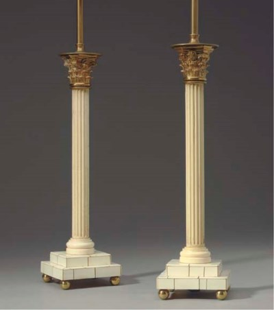 A PAIR OF IVORY AND GILT-METAL