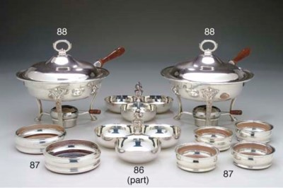 A SET OF FOUR SILVER-PLATED TR