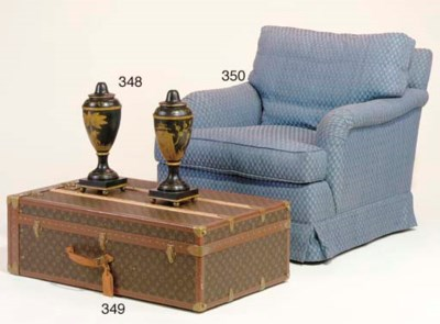 A CONTEMPORARY UPHOLSTERED CLU