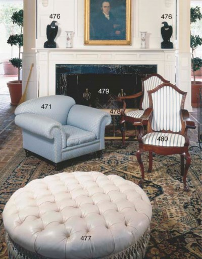 A CREAM LEATHER UPHOLSTERED CI