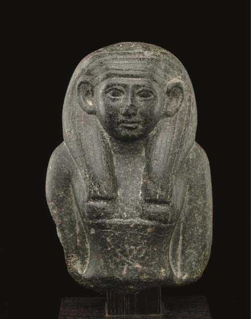 AN EGYPTIAN BLACK GRANITE BUST OF A WOMAN