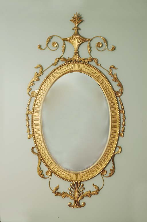 AN EDWARDIAN GILTWOOD MIRROR