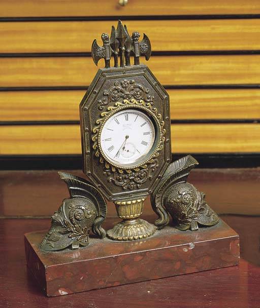 A GEORGE IV BRONZE WATCH STAND