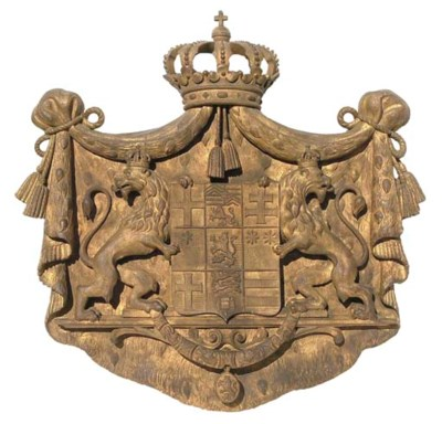 A GERMAN CARVED GILTWOOD COAT-