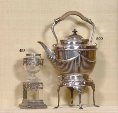 An English silver teakettle on