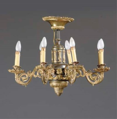 A FRENCH PATINATED AND GILT BR