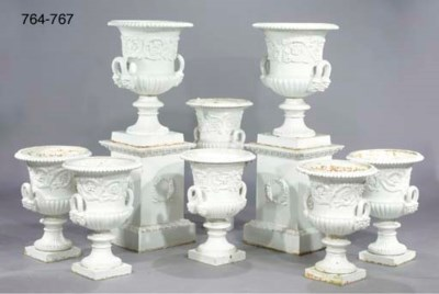 A PAIR OF WHITE PAINTED CAST-I