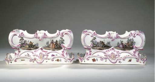 A pair of Vienna porcelain rectangular jardinières and stands
