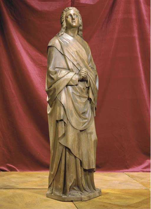 A SOUTH-GERMAN STAINED CARVED WOOD FIGURE OF A SAINT