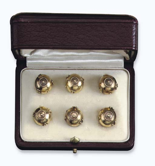 A PAIR OF GOLD BUTTONS