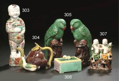 A pair of models of parrots