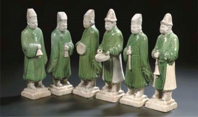 A set of six green-glazed pott