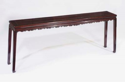 A carved lacquered altar table
