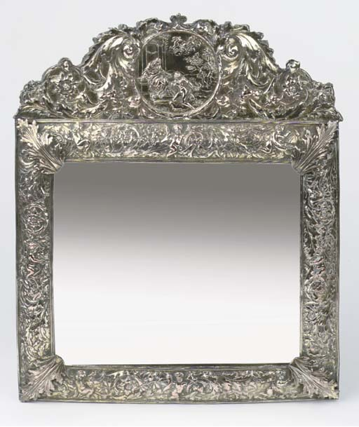 A large silver-plated toilet m
