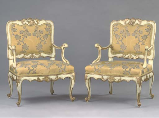 A PAIR OF GERMAN PARCEL-GILT AND CREAM-PAINTED FAUTEUILS