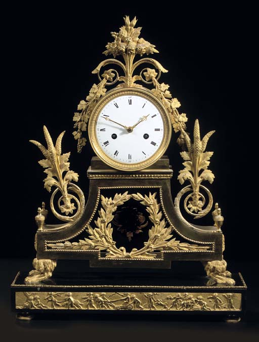 A DIRECTOIRE ORMOLU AND BLACK MARBLE STRIKING MANTEL CLOCK