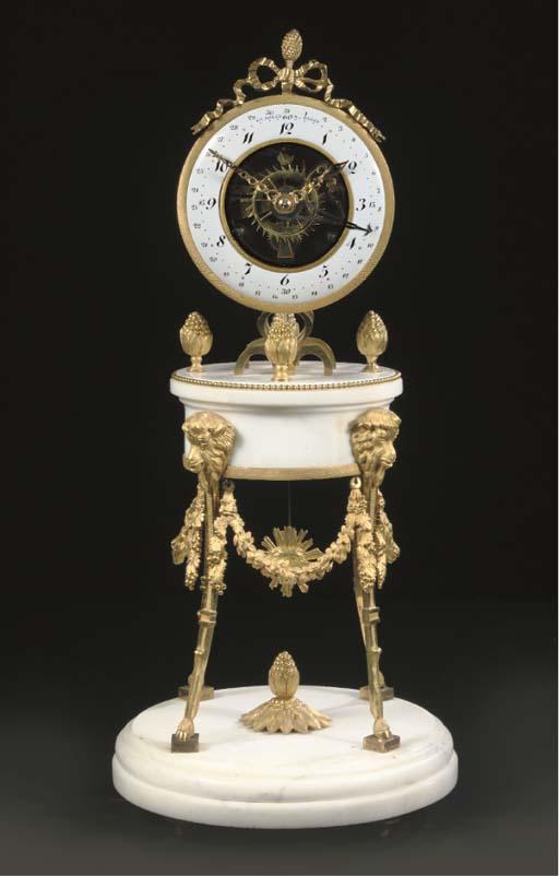 A LATE LOUIS XVI ORMOLU AND WHITE MARBLE STRIKING SKELETON CLOCK