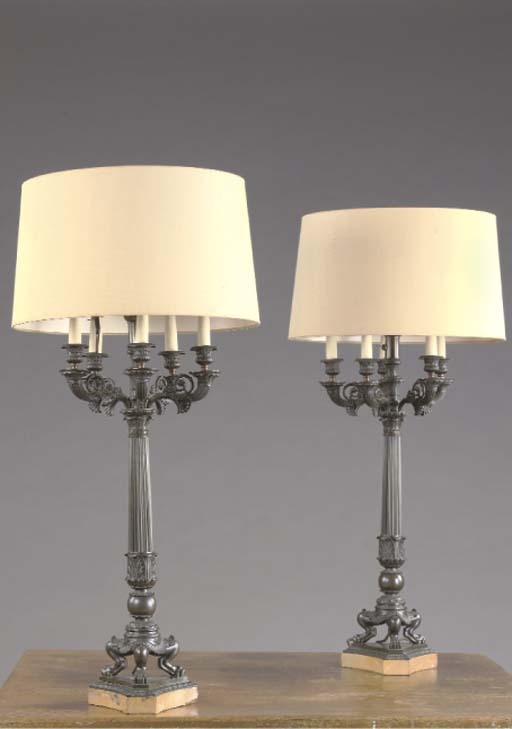 A PAIR OF RESTORATION PATINATED BRONZE SIX-LIGHT CANDELABRA MOUNTED AS TABLE LAMPS