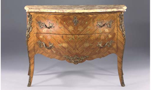 A BRASS-MOUNTED TYLIPWOOD AND MARQUETRY COMMODE
