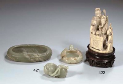 AN IVORY GROUP OF A SEATED MAN