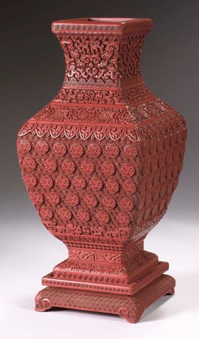 A red lacquer baluster vase an