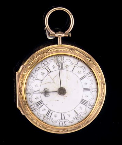 AN 18K GOLD OPENFACE REPOUSSE