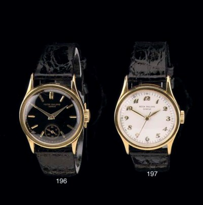 AN 18K GOLD WRISTWATCH WITH BL