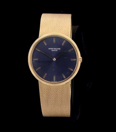 AN 18K GOLD AUTOMATIC WRISTWAT