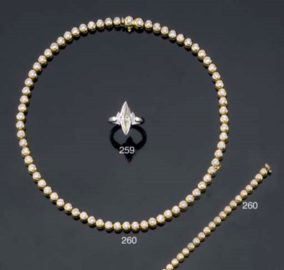 A DIAMOND LINE NECKLACE AND BR