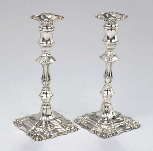 A pair of English silver candlesticks
