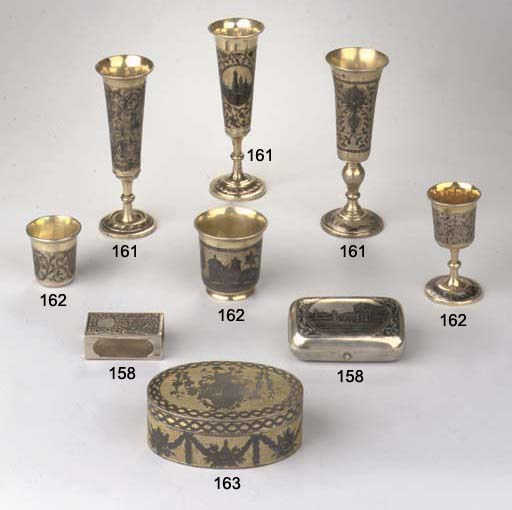 Three various silver-gilt and niello champagne flutes