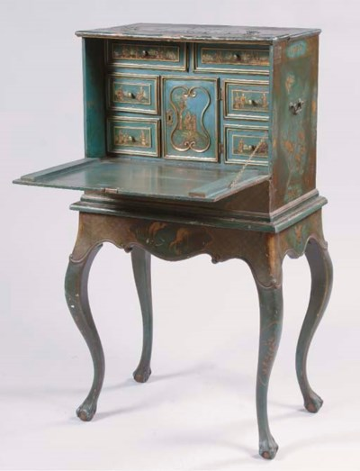 A GILT AND BLACK JAPANNED CABI