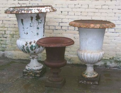 THREE CAST-IRON GARDEN VASES