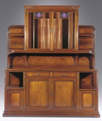 A carved mahogany cabinet