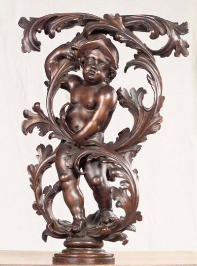 A STAINED CARVED WOOD FIGURE O
