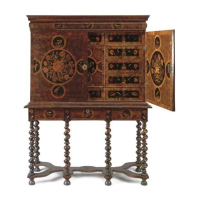 AN OYSTER-VENEERED WALNUT AND