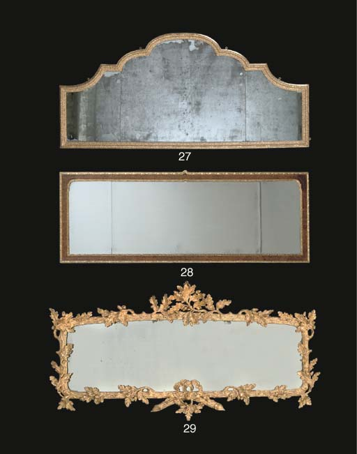 A GILT-GESSO OVERMANTEL MIRROR
