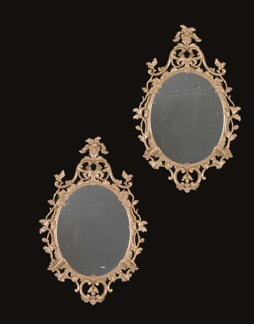 A PAIR OF GILTWOOD OVAL MIRROR