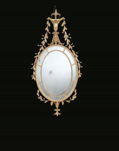 A GILTWOOD OVAL PIER GLASS