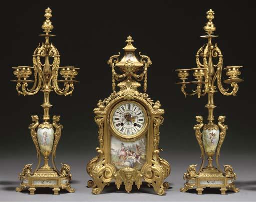 A Napoleon III ormolu and enamel-mounted three-piece garniture
