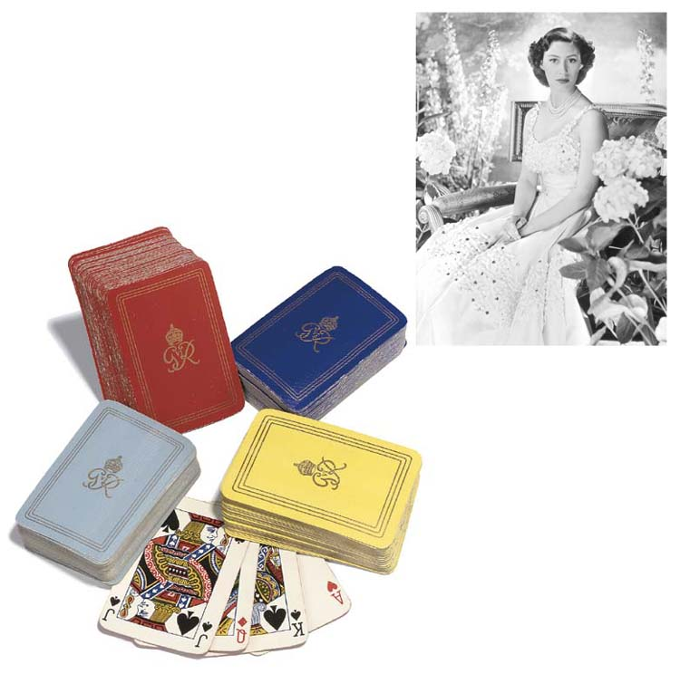 Four sets of playing cards wit