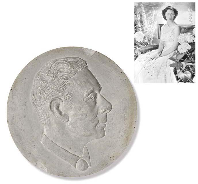 A plaster portrait roundel of